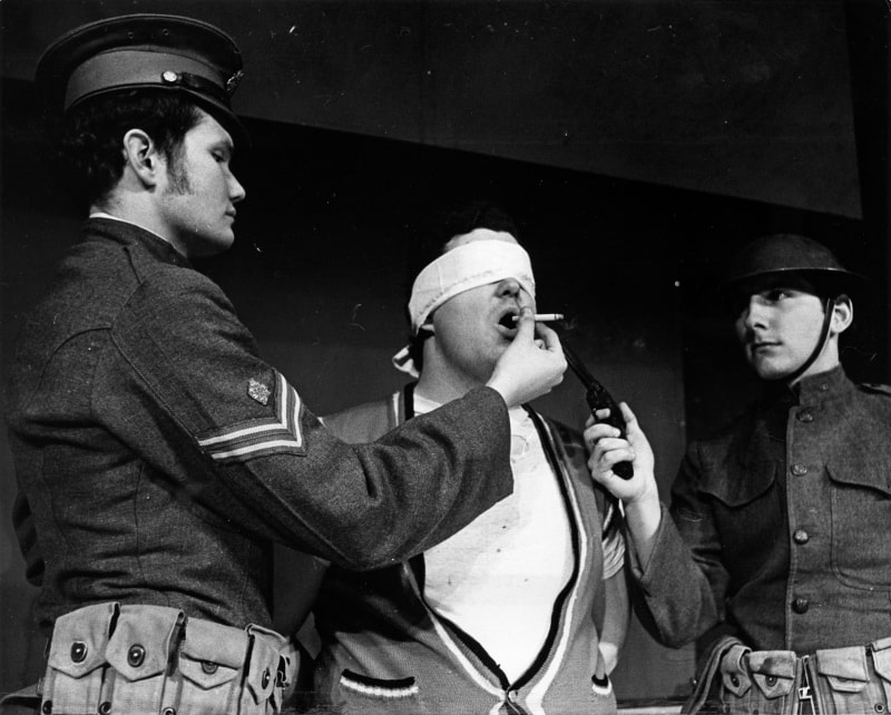 Craig Dunkerly '69, Dave Stewart '68, and Toby Webb '69 in a scene from A Man's A Man by Bertolt Brecht.