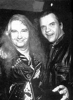 photo of Jim Steinman and Meat Loaf, both wearing leather jackets