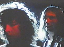 Karla DeVito (left, turning away) and Jim Steinman (right, facing Karla)