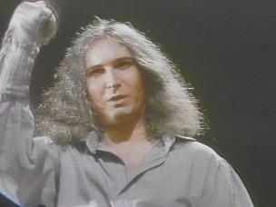 Jim Steinman in the role of Peter, raises his silver-gloved right fist