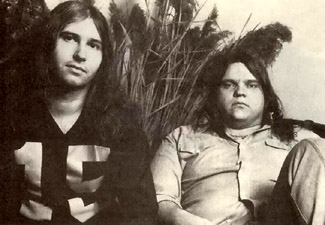 1978 photo of Jim Steinman (left) and Meat Loaf (right), both seated