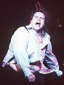 vintage 1978 photo of Meat Loaf in concert - his hair flying, his shirt parted